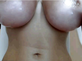 Big Oiled Titty Closeup