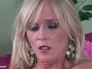 Sexy blonde MILF lady masturbates in her bedroom
