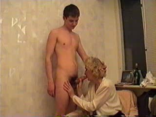 Mature Lady And a Young Guy Take Some Wine