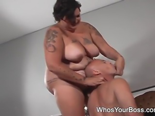 Slutty tattooed femdom with huge tits punishing her male slave on the floor