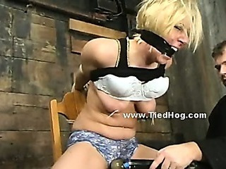 Blonde drab tied like a hog in underground room where pervert man brings his victims to oppress