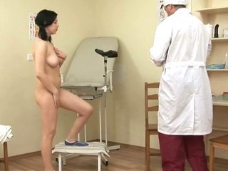 Brunette Gets Her Pussy Probed By Her Doctor