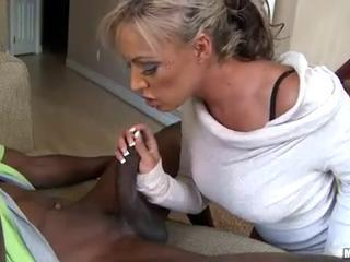 Tanned blonde with huge tits and tattoo sucks black pecker