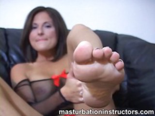 Jerky teacher puts her feet up and demos footjob skills