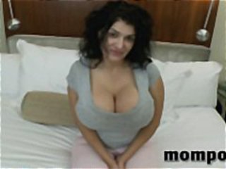 Huge tits on this brunette MILF as she uses them and her mouth