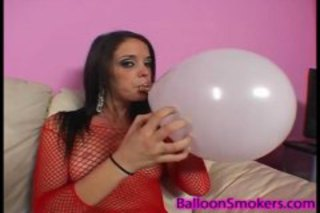 Bonnie popping balloons in fishnets