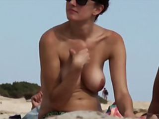 Two chicks caught on spy cam sunbathing topless at the beach