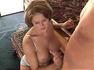 Busty brunette babe Eve gives this guy a nice handjob for cum