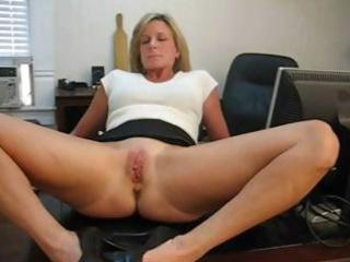 mature blonde secretary spreads her feet and