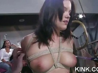 Inviting hot babe bound, oiled