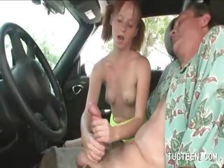 Teen bitch tugging a dude's penis in car