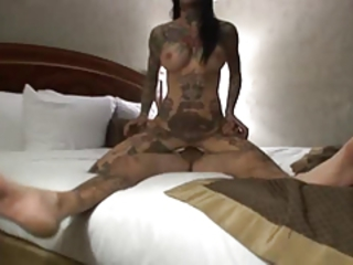 Tattooed couple sex