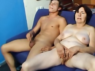 Nasty brunette granny spreads her hairy pussy for a young stud