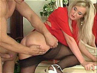 Blonde babe in nylons sucks his cock before getting fucked by it