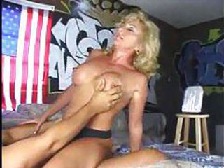 Blonde milf uses tits to seduce a younger man tubes