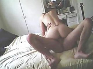 Camera to the side of the bed films couple fucking tubes