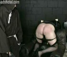 Bending over nun with her panties down got spanked with a wooden stick on her ass by priest