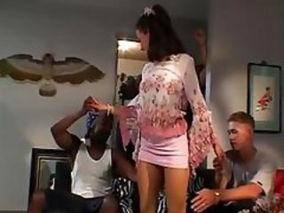 Brunette is used and abused by two hard black cocks at home