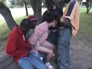 French mature wife : interracial gangbang at public park