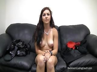 cute dark haired on the casting couch gets naked and bangs cock