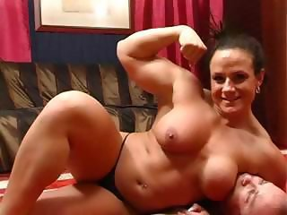 Muscle chick wrestles her husband on the floor and does a bit of face sitting