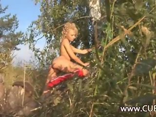 Ultra hot blonde fingering sweet pussy in a forest