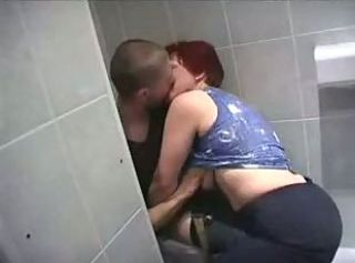 Mother and son in a toilet