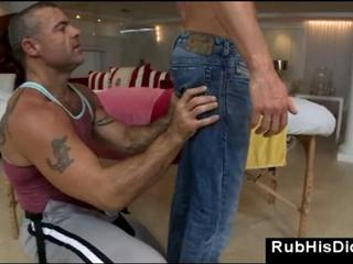 Gay guy massages straight male client with oil