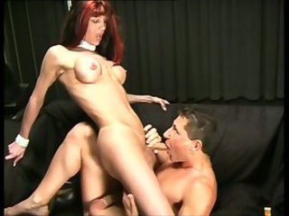 Sexy tranny is banged by white bitch in the nice dark room