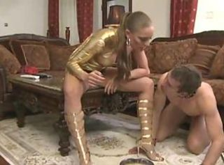 Submissive naked guy in a collar fulfilling all his mistress dog co...