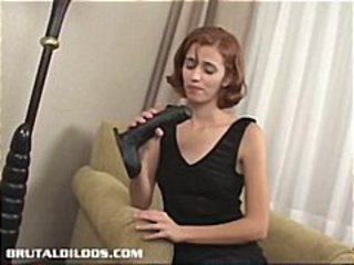 Petite young redhead takes a big black dildo in her skinny little twat