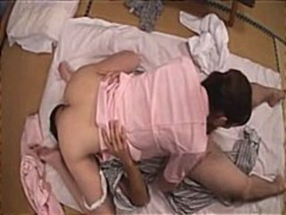 Hot young Japanese chick rubs and licks his dick and gets pounded
