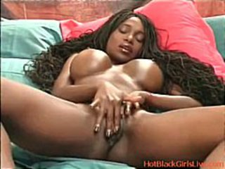 Hot ebony babe with big boobs is rubbing her pussy on cam