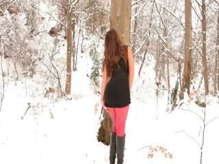 Red-hot nylon pantyhose in winter forest