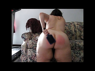 spanking with a paddle brush...