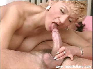 Mature Italian gal with champagne-colored hair goes down..