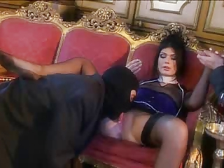Two masked men fucking a glamorous slut