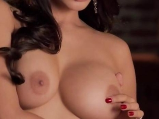 brunette with fat tits on brown couch