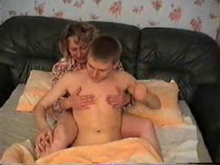Mature Lady With A Boy