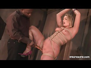 Sexy blonde in rope bondage rims black ass tubes