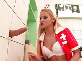 Nurse sucks dick through a gloryhole tubes
