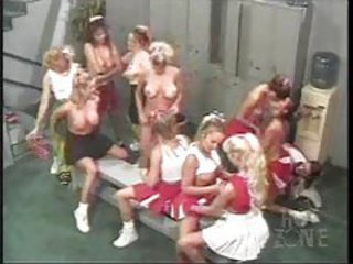 Many cheerleader babes playing there pigeon-hole court tubes