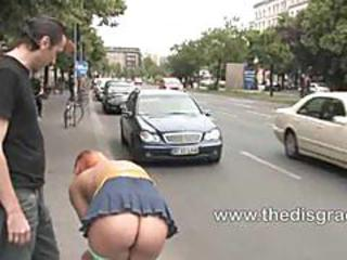 Flexible Redhead Is Bound And Stripped Naked In Public