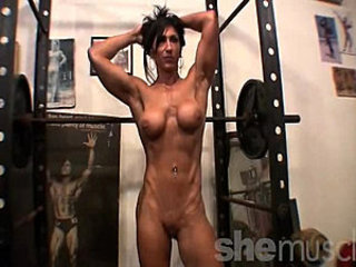In this SheMuscle® gym video, a hottie is bodybuilding, prosecution squats,...