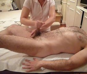 Female massage therapist performs hand relief