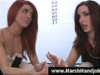 Two angry babes give harsh handjob