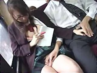 Schoolgirl exposed to a bus is played with and forced to back a handjob