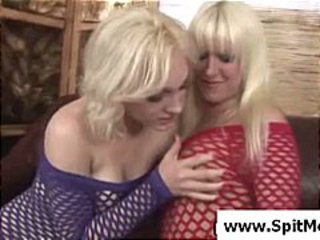 Two blonde lesbian babes swapping spit and licking it off