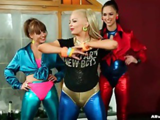 Girls in shiny spandex make a mess with champagne tubes
