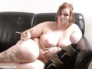 Big chubby cutie with tattoos smokes whilst naked tubes